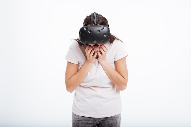 Image of surprised happy woman wearing virtual reality device .