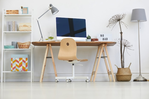 Image of table with computer monitor on it in domestic room at home