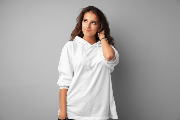 Image of thinking young woman standing