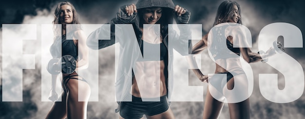 The image of three sports sexy girls on a smoky background. fitness and bodybuilding concept. high quality