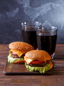 Image of two fresh hamburgers and two glasses of juice
