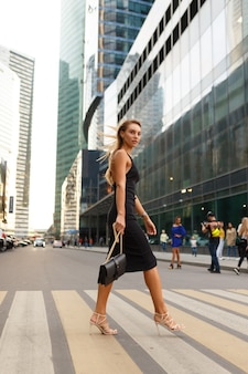 Image with an attractive girl waking on the street
