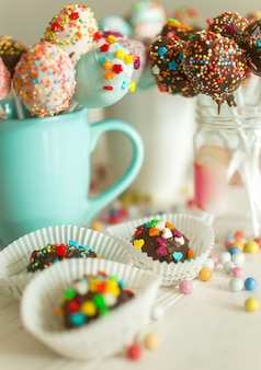 Image with photo filter of candies and pop cake