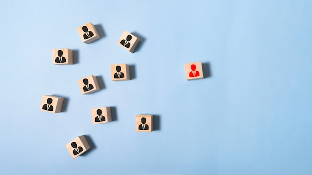 Image of wooden blocks with people icons over mint table,building a strong team, human resources and management concept.
