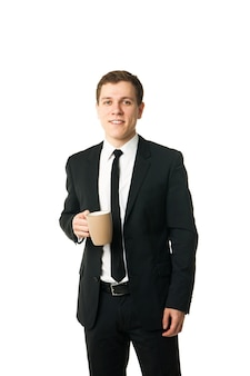 Image of young businessman with cup of coffee isolated on white