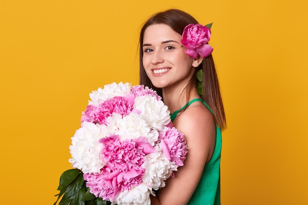 Image of young good looking cheerful brunette looking directly at camera