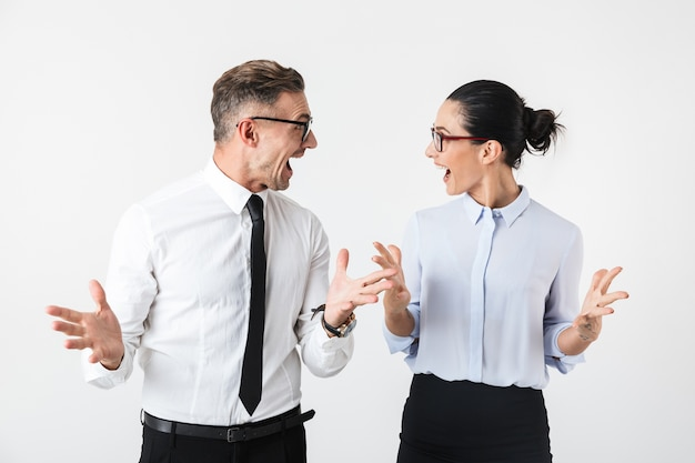 Image of young happy business colleagues couple isolated over white wall.