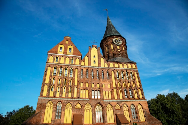 Immanuel kant cathedral in kaliningrad, russia. former konigsberg. the monument is a historic building on the background of blue sky
