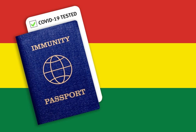 Immunity passport and covid test over the national flag of bolivia