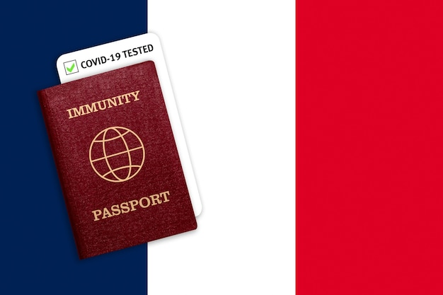 Immunity passport over the national flag of france.