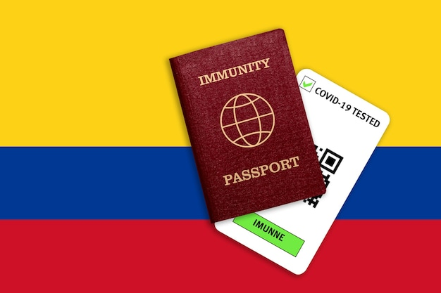 Immunity passport for traveling and test result for covid on flag of colombia