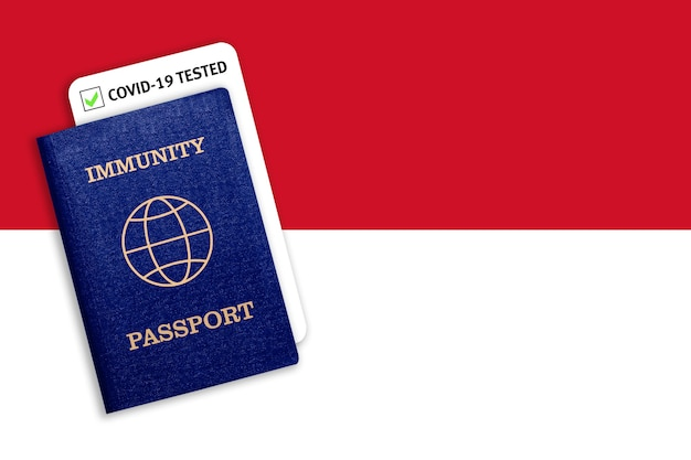 Immunity passport with covid test on the national flag of indonesia