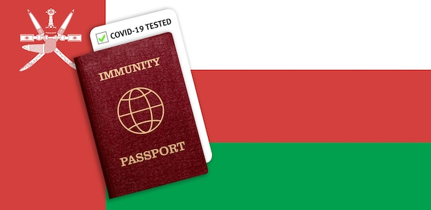 Immunity passport with covid test on the national flag of oman