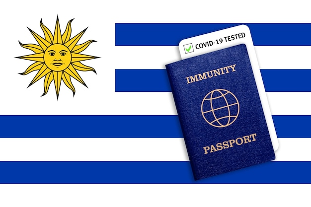Immunity passport with covid test on the national flag of uruguay