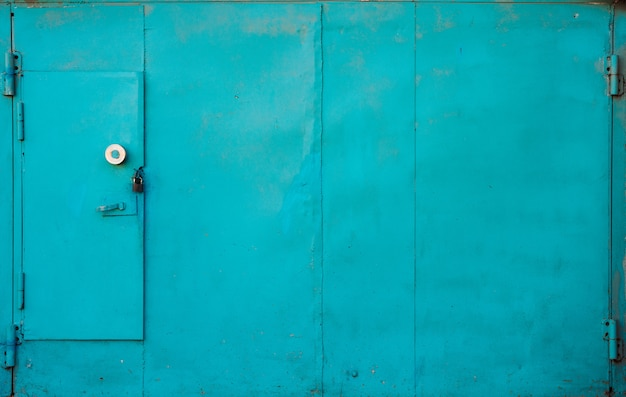 Imperfect blue metallic garage gate close up