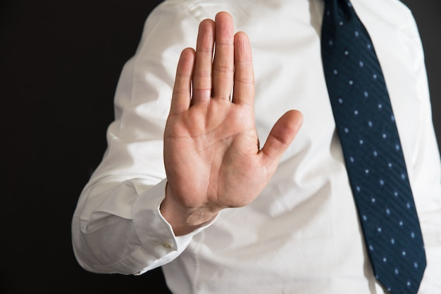 Imposing stop with gesture of a hand