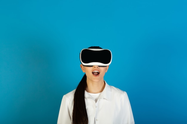 Impressed woman wearing in glasses of virtual reality.