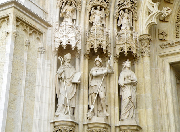 Impressive sculptures of saints and archangels on the facade of zagreb cathedral, croatia