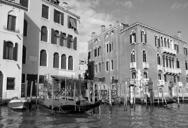 Impressive traditional buildings along the grand canal of venice, italy in monochrome