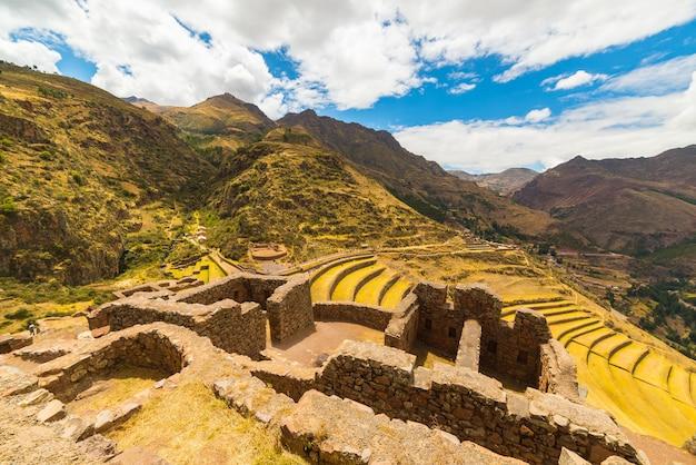 Inca terraces and building ruins in pisac, sacred valley, peru