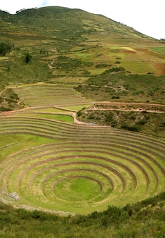 Incan ruins of moray, terraced rings on the high plateau of the village of maras, cusco, peru