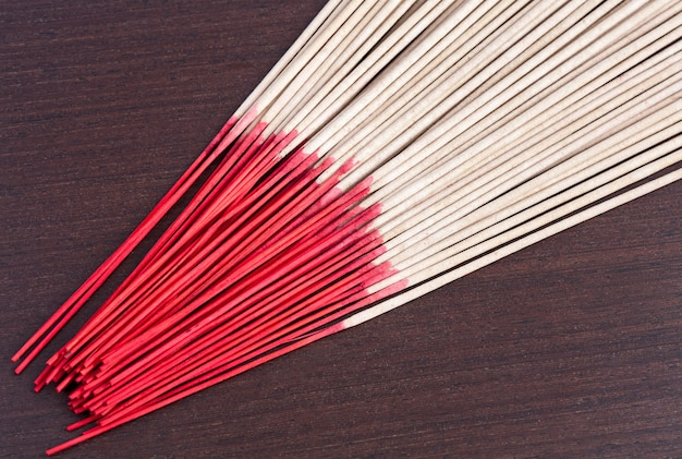 Incense aromatic sticks on wooden background
