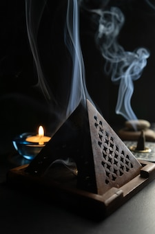 Incense burner releasing a thick smoke