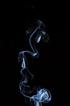 Incense smoke on a black background.