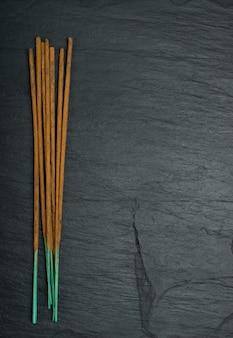 Incense spa aroma sticks on black background