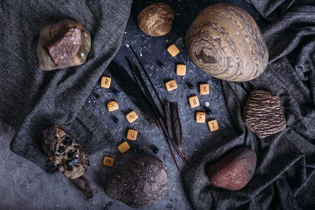 Ароматические палочки среди мрачной и эзотерической атрибутики, рунных камней.