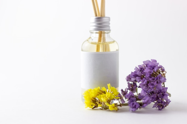 Incense sticks for home with floral scent. flowers and dried flowers with aroma diffuser. eco-friendly home fragrance concept
