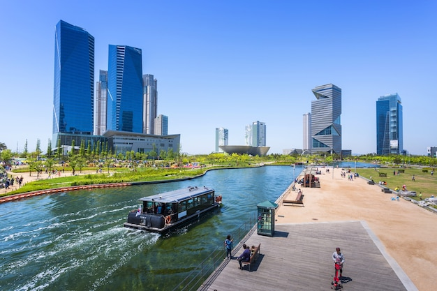 Incheon, south korea - may 05, 2015: people are riding a tourist boat in summer of korea at central park in songdo district, incheon south korea.