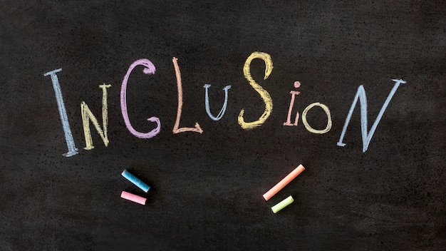 Inclusion word written in colourful chalk
