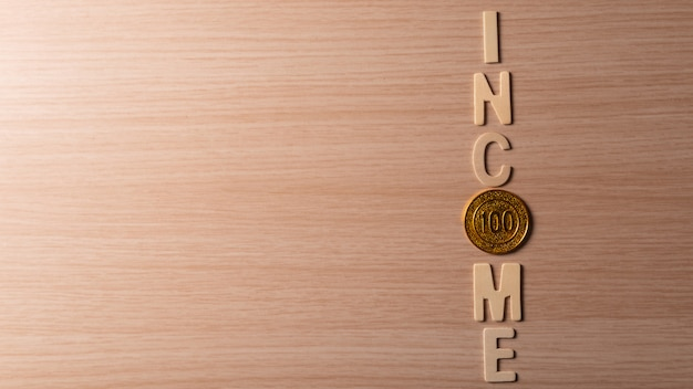 Income lettering with coin