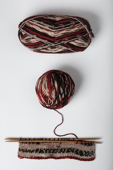 Incomplete knitting project with ball of wool isolated