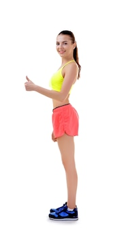 Incorrect posture concept. young woman showing thumb up gesture on white background