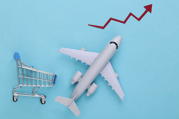 Increased international shipping. shopping trolley and plane with growth arrow on a blue