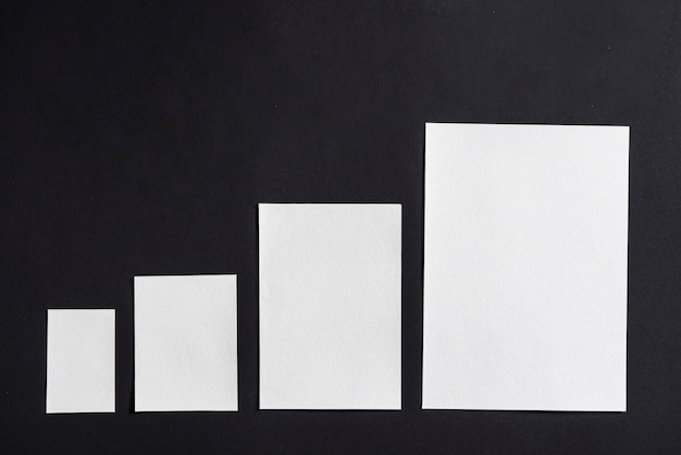 Increasing size of blank white papers in row
