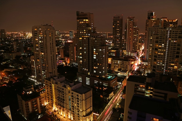 Incredible aerial view of cityscape with skyscrapers of bangkok downtown at night