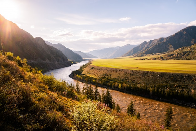 Incredible landscape of altai mountain valley with river at sunset. altai mountains landscape