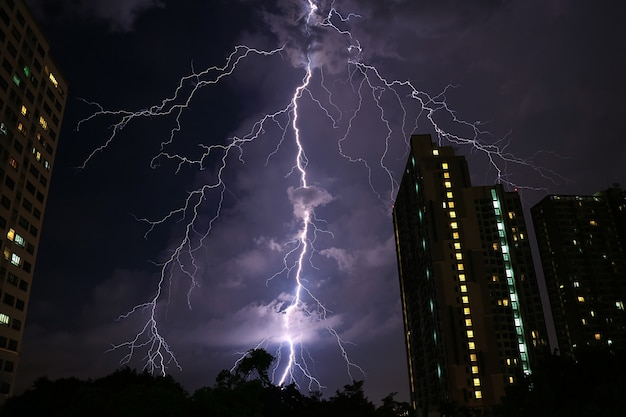 Incredible real lightning striking on night sky of bangkok urban
