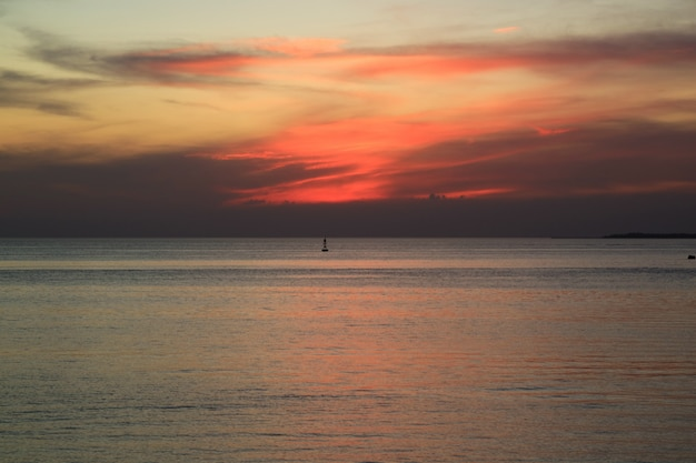 Incredible sunset afterglow on the cloudy sky over the gulf of thailand, central region, thailand