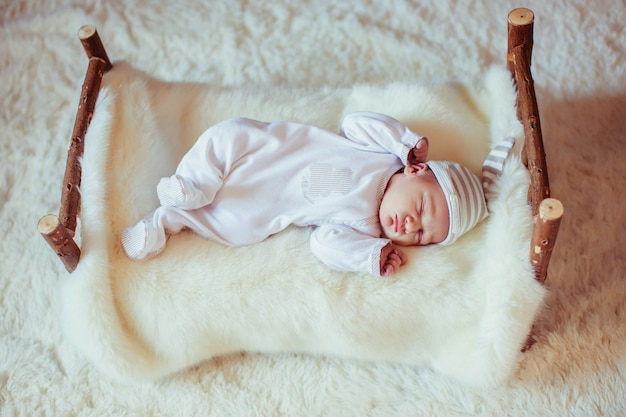 Incredible and sweet newborn baby sleeps on the bed