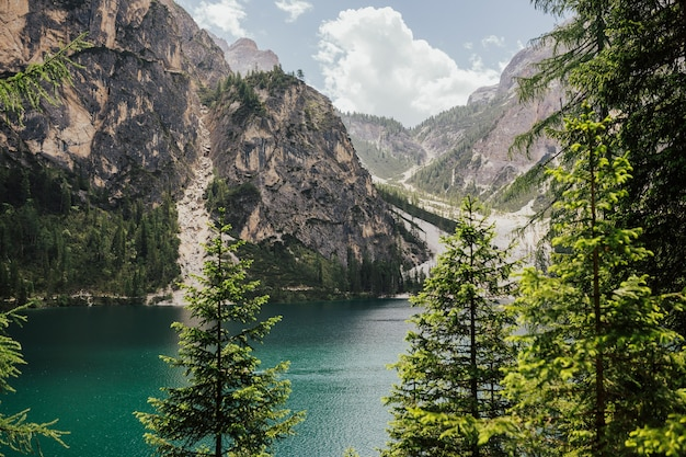 Incredible view on majestic famouse lake braies during sun time.