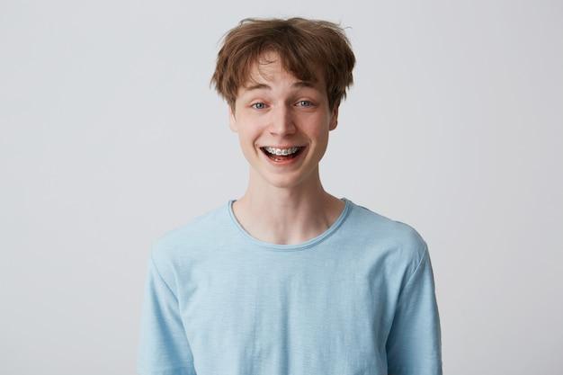 Incredibly, over-measure joyful guy smiles broadly