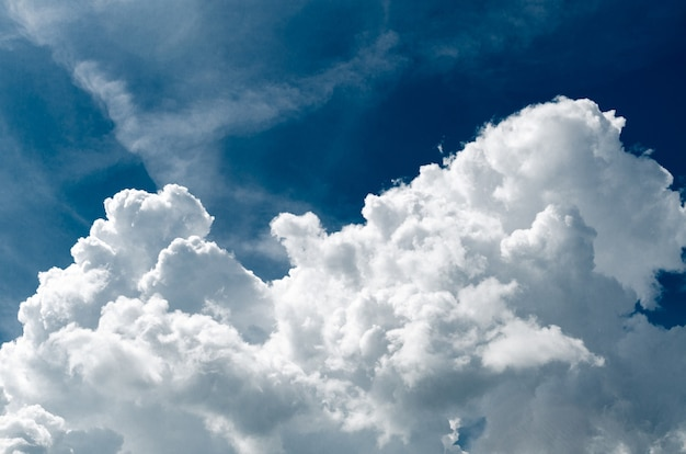 Incredibly wonderful lush cumulus clouds against a blue sky - image