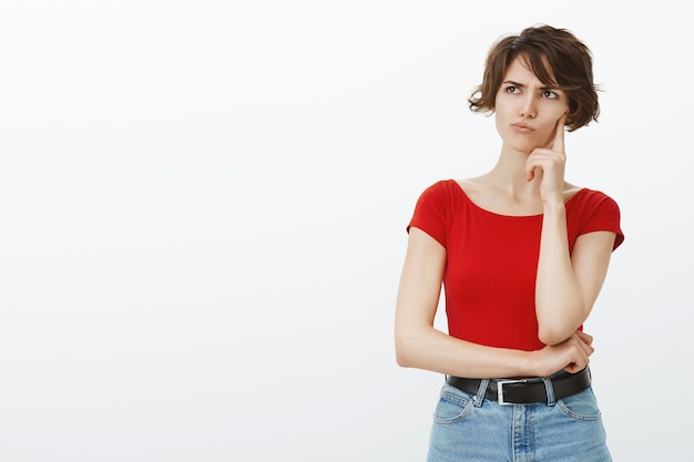 Indecisive and perplexed woman searching for solution, making choice and thinking