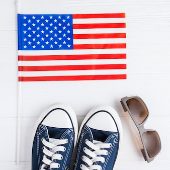 Independence day background with shoes and sunglasses