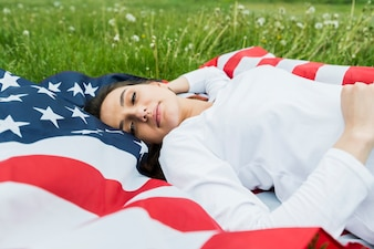 Independence day concept with relaxed woman and american flag