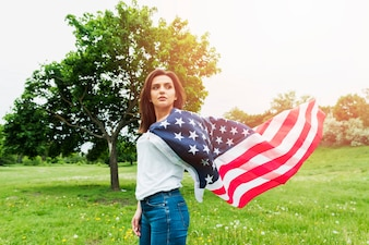 Independence day concept with woman and american flag